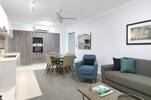living room of 3 bedroom dual key apartment at Oaks Carlyle hotel in Mackay with air con and wi-fi