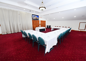 Rockerfeller conference room set for event at Oaks Grand Gladstone hotel in Queensland with whiteboard and air con