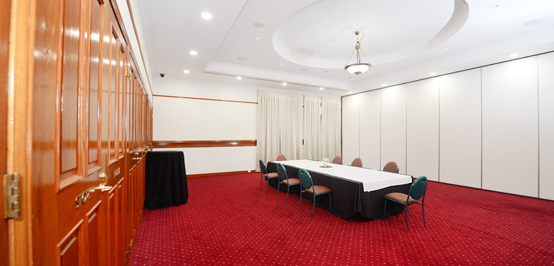 large functions room at Oaks Grand Gladstone hotel with catering, furniture and microphone for speakers