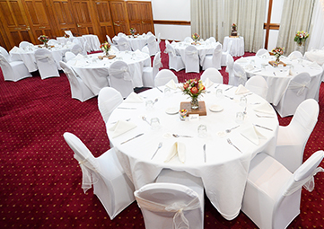 table setting in large indoor wedding venue for hire in Gladstone near airport
