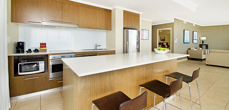 Fully equipped kitchen with microwave and oven in 3 bedroom apartment Hervey Bay, Queensland