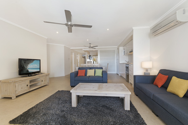 Big lounge area with TV and air conditioning in 1 Bedroom Ocean View hotel room Hervey Bay