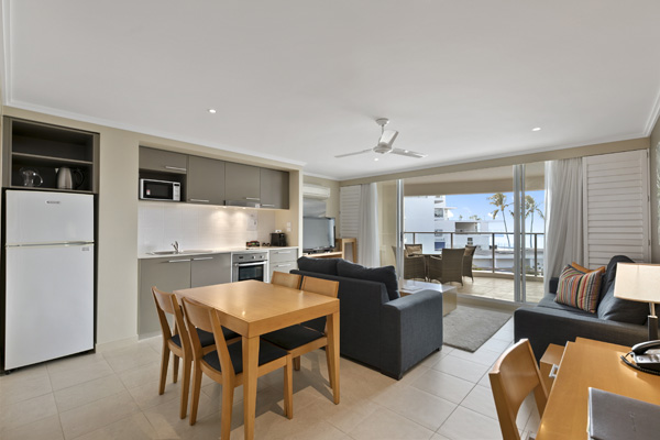 Spacious living room in 1 Bedroom Ocean View hotel room with balcony Hervey Bay