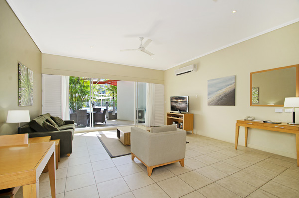 Living room with office work desk Oaks Hervey Bay 1 bedroom resort apartment
