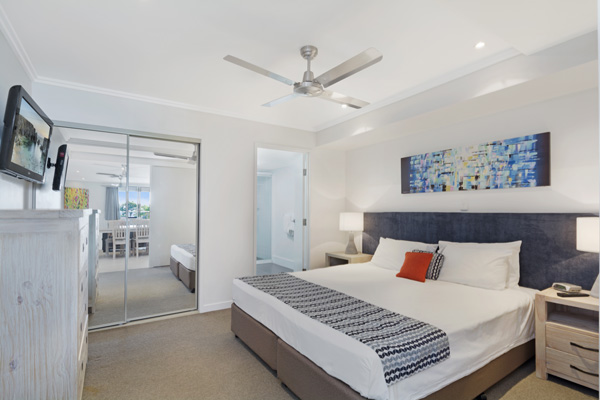 King size bed in master bedroom of air conditioned 2 Bedroom Penthouse, Hervey Bay