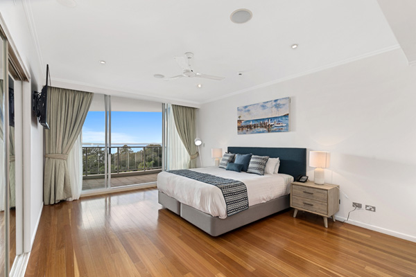 Spacious, air conditioned room with king size bed in 2 Bedroom Penthouse, Hervey Bay resort
