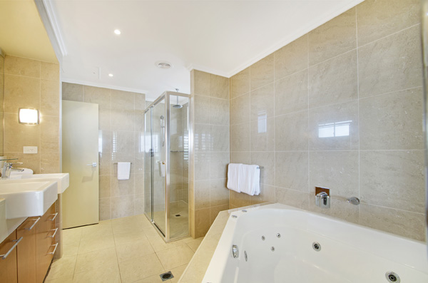 Spa bath in ensuite bathroom of 2 Bedroom holiday apartment in Hervey Bay