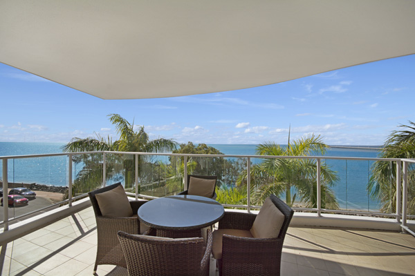 Table and chairs on balcony with ocean views at best Hervey Bay resort hotel