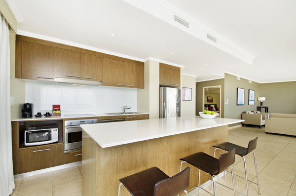Kitchen with oven and dishwasher in large 3 bedroom holiday apartment with ocean views in Hervey Bay
