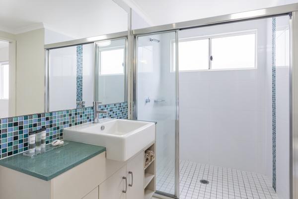 en suite bathroom in 1 bedroom apartment near beach in Port Douglas at Oaks Lagoons hotel