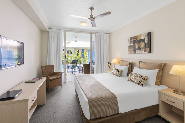 air conditioned hotels Port Douglas master bedroom in 2 bedroom apartment with Wi-Fi in Port Douglas
