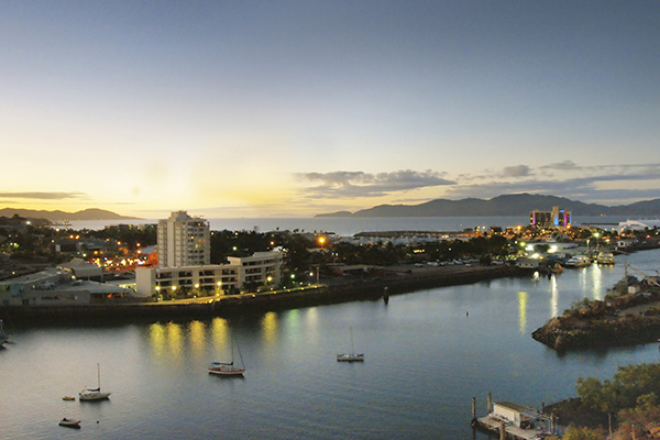 view of Ross Creek and Townsville Harbour at sunset from balcony of studio apartment at Oaks M on Palmer hotel in Townsville