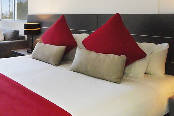 Pillows on comfortable clean bed in studio apartment at Oaks Metropole Hotel in Townsville