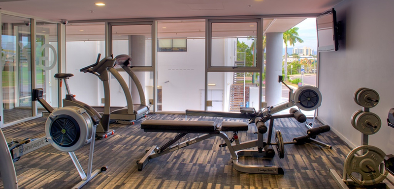 Fully equipped gym with rowing machine, treadmill and weights at Oaks Metropole Hotel in Townsville