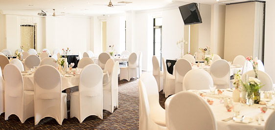 Guests in Oaks Metropole Hotel wedding venues Townsville ballroom with bride and groom