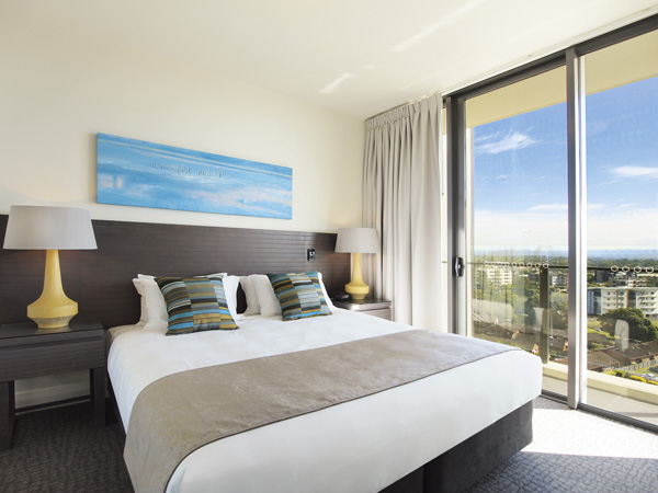 air conditioned bedroom in 3 bed apartment with wi-fi and balcony with views of Redcliffe at Mon Komo Hotel near airport