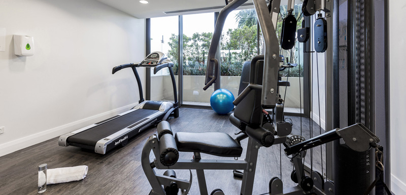 fully equipped gym with treadmill and weights machines in Redcliffe at Oaks Mon Komo Hotel