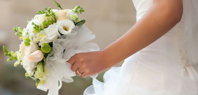 woman holding bouquet during ceremony at Redcliffe wedding venues in Moreton Bay