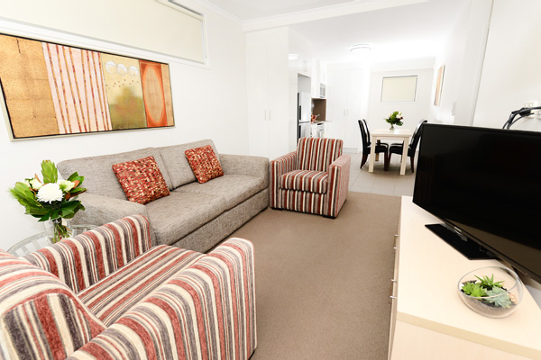 living room in best Moranbah hotels with TV and Foxtel in 2 bedroom apartment at Oaks Moranbah hotel in Queensland, Australia
