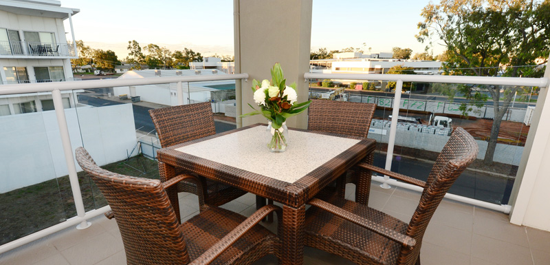 Moranbah hotels private balcony with table and chairs overlooking Moranbah town in Queensland, Australia