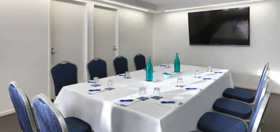 functions venue for hire with tv, catering, tables and chairs prepared for conference in Caloundra, Sunshine Coast