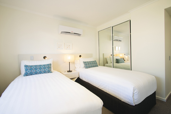 two single beds in air conditioned 2 bedroom apartment with wi-fi and full length mirror