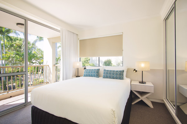 air conditioned bedroom of 2 bedroom apartment with Wi-Fi and private balcony at Oaks Oasis Resort hotel in Caloundra, Sunshine Coast