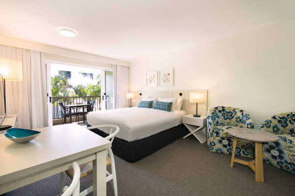 air conditioned bedroom with big, comfortable, bed in 2 bedroom dual key apartment at Oaks Oasis Resort hotel in Caloundra, Sunshine Coast