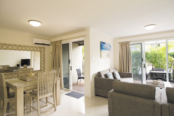 spacious living room area in Caloundra hotels 3 bedroom villa with air conditioning and private balcony at Oaks Oasis Resort hotel in Caloundra