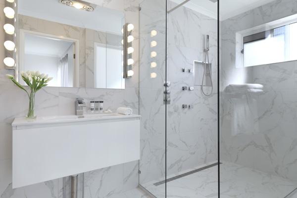 en suite bathroom with large adjustable shower, mirror and toilet in 3 bedroom villa at Oaks Oasis Resort hotel in Caloundra on Sunshine Coast, Queensland, Australia