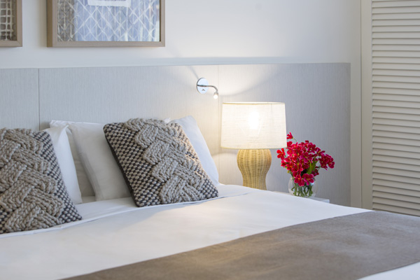 close-up view of clean, comfortable pillows on queen size bed with side tables and lamp in Executive King hotel room apartment at Oaks Oasis Resort in Caloundra on Sunshine Coast, Queensland, Australia