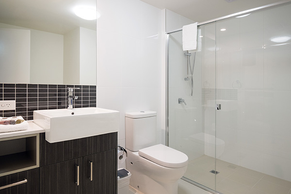 en suite bathroom with shower and toilet in two bedroom apartment at Oaks Rivermarque hotel in Mackay, Queensland, Australia