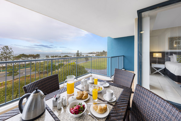 table with healthy breakfast on private balcony of 2 bedroom ocean view apartment walking distance from the beach at Oaks Seaforth Resort hotel, Sunshine Coast