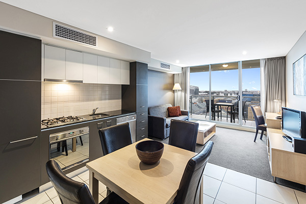 Hotel accommodation Adelaide CBD 1 bedroom apartment living room near Convention Centre at Oaks Embassy in South Australia