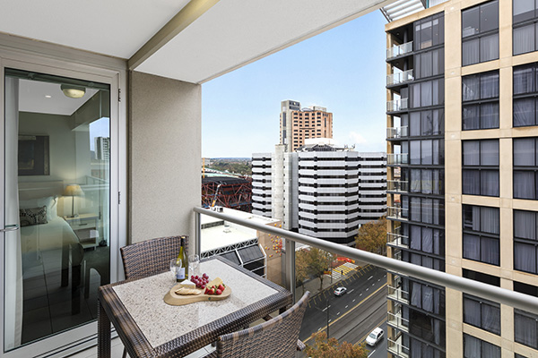 balcony with furniture outside family friendly 3 bedroom executive apartment in Adelaide city with CBD views