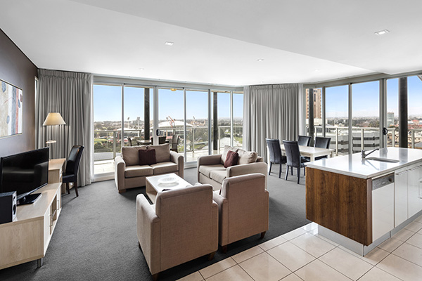 serviced apartments Adelaide cbd with big windows and Foxtel on TV with spacious balcony outside in Adelaide city centre
