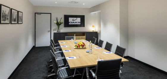 Oaks Embassy Adelaide conferencing room 2 with boardroom setup, air conditioning and Wi-Fi access