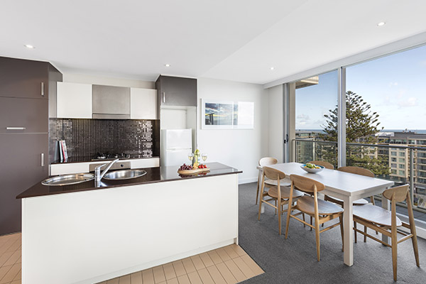open plan living room and kitchen with air conditioning, Wi-Fi and car parking at Oaks Liberty Towers hotel in Glenelg, South Australia