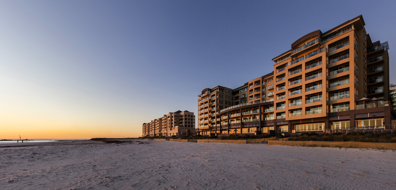 external view of Oaks Plaza Pier beachfront hotel in Glenelg, South Australia at sunset