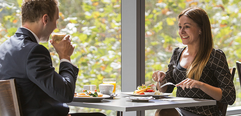 man and woman enjoying vegan meal during lunch at 1st Floor Restaurant on Collins St in Melbourne city