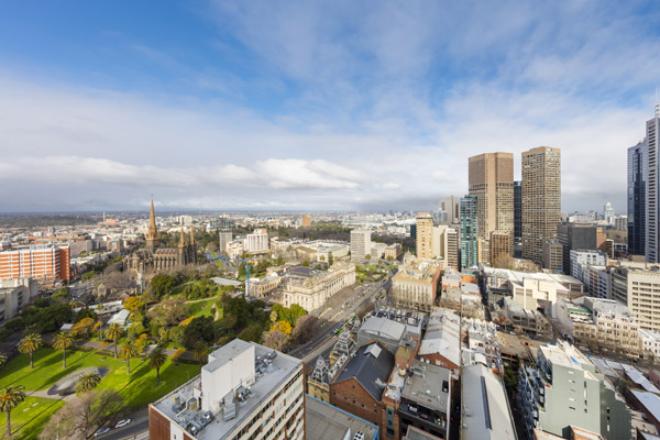 panoramic view of Melbourne CBD at midday from large private balcony of 1 bedroom apartment at Oaks on Lonsdale hotel, Melbourne city, Victoria, Australia