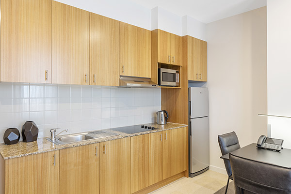 open plan studio in hotels near Etihad Stadium with microwave and counter tops for food preparation at Oaks on Market in Melbourne city, Victoria, Australia