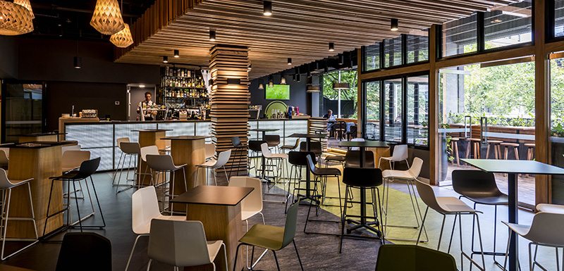 interior view of Oak and Vine restaurant with chairs, tables and vegetarian meals on Market St in Melbourne city, Victoria, Australia