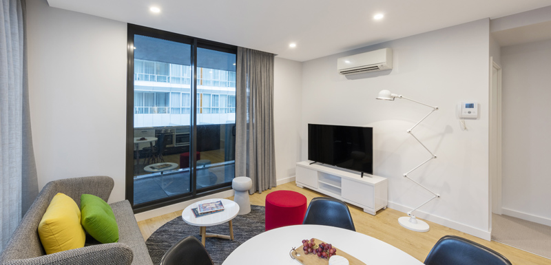 2 Bedroom hotel apartment in Melbourne city with air con, Foxtel on flat screen television and small private balcony outside