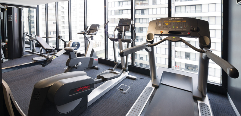 fully equipped hotel gym in Melbourne with treadmill, weights, rowing machine and air conditioning at WRAP On Southbank