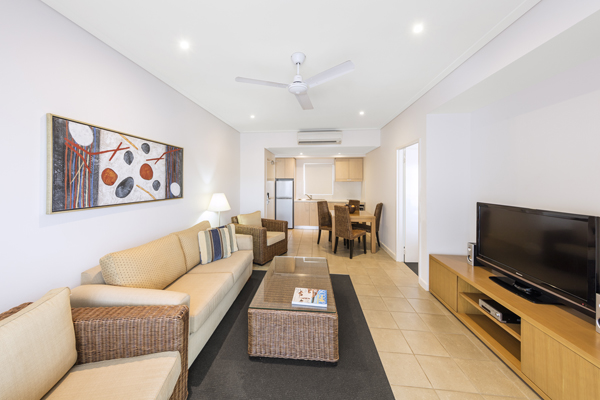 spacious, air conditioned living room with dining table, air con and Foxtel on TV in 2 bedroom apartment at Oaks Broome hotel, Western Australia