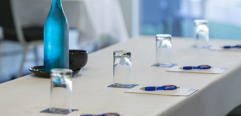 pens on notepads on table in air conditioned conference room for hire with catering in Broome, Western Australia