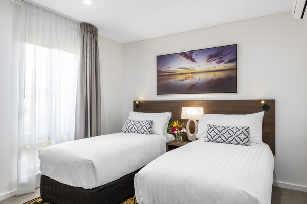 two single beds in air conditioned 3 bedroom hotel apartment accommodation with Wi-Fi access at Oaks Cable Beach Sanctuary in Broome, Western Australia