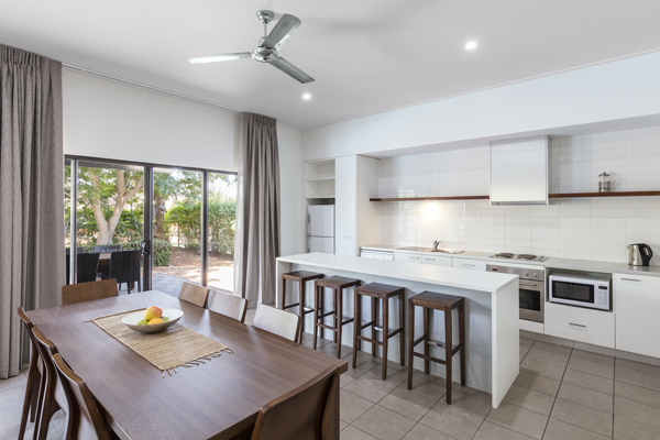large open plan dining room and kitchen in Cable Beach Hotels with modern applicances including oven, microwave and stove in 3 Bedroom Villa at Oaks Cable Beach Sanctuary hotel in Broome, Western Australia