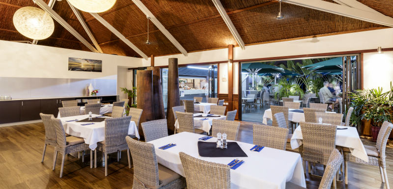 indoor air conditioned dining area with tables and chairs ready for guests at Cables Restaurant and Bar in Cable Beach, Broome, Australia